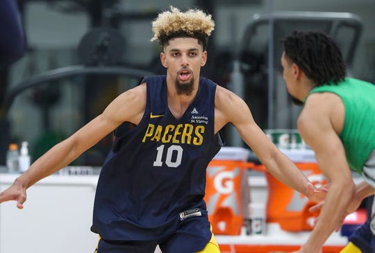 Brian Bowen II (10) works the court during Indiana Pacers rookie/free agent camp at the St. Vincent Center in Indianapolis, Monday, July 1, 2019.