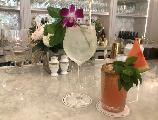 An orchid decorates gin and tonic and watermelon bumps up the Moscow Mule at Cake Bake Shop's full bar. The restaurant and bakery opened July 1, 2019, at Carmel City Center, 800 S. Rangeline Road.