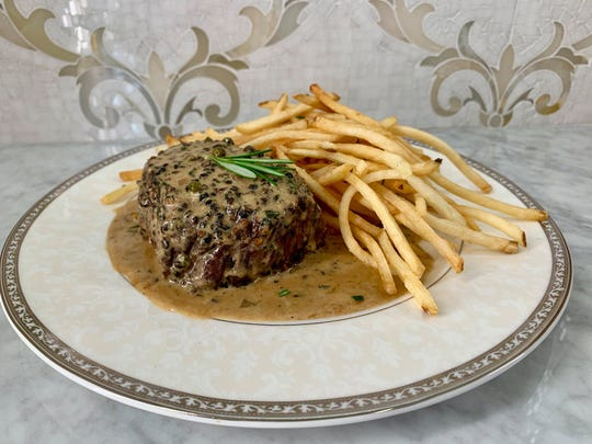 Filet au poivre and pommes frites is among French dishes on the entree menu at Cake Bake Shop in Carmel. The restaurant and bakery opened July 1, 2019, at Carmel City Center.