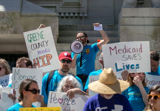 Participants in the Save Hoosier Healthcare Rally gather at Monument Circle in downtown Indianapolis on Monday.