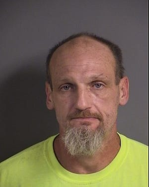 Darrell Lee Abbott, 46, faces assault charges after he allegedly used a pipe to hit a man as he shouted racial expletives toward the victim June 15, 2019.