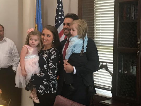 Jackson Mayor Scott Conger, his wife Nikki, and their two children Madelynn and Charlie get a few family pictures before Conger started working on Monday, July 1, 2019.