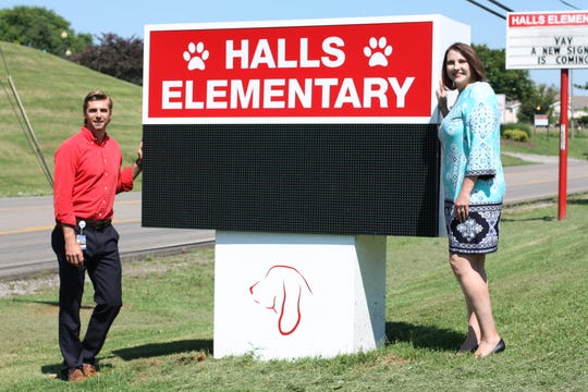 """""""My goal is to build those relationships and that the community knows I am here to support and serve and add value,"""" said new Halls Elementary assistant principal Nathan Lynn, pictured with new principal Jamey Romig in front of the new digital sign on June 28, 2019."""