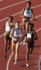 Kameisha Bennett, with Jearl Miles-Clark, right, Nicole Teter, center, and Hazel Clark in the women's 800 meters finals at the U.S. Olympic track and field trials in Sacramento, Calif., Monday, July 12, 2004.