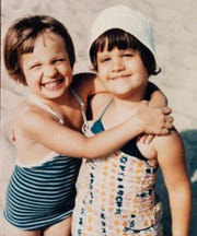 Fraternal twin sisters Patty (left) and Peggy Favorite posed for a picture at a Lake Michigan beach on their fourth birthday.