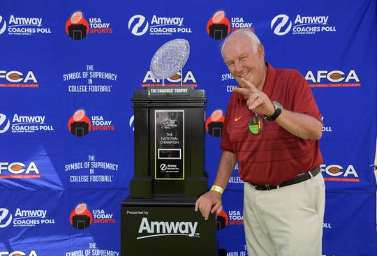 Sep 2, 2017; Los Angeles, CA, USA; Southern California Trojans former coach John Robinson poses with the AFCA Coaches Trophy presented by Amway prior to the game against the Western Michigan Broncos at the Los Angeles Memorial Coliseum. Mandatory Credit: Kirby Lee-USA TODAY Sports