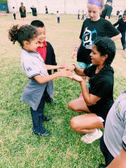 NSU soccer junior Ashley Medawattage plays a game with a Guatemalan child during a soccer youth clinic during the team's trip to Guatemala City, Guatemala, in mid-May.