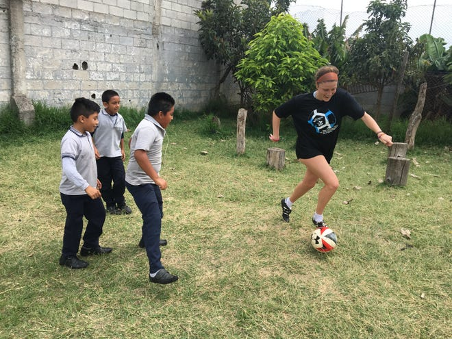 NSU soccer junior Courtney LeJeune demonstrates a dribbling drill in a youth clinic during the team's trip to Guatemala City, Guatemala, in mid-May.
