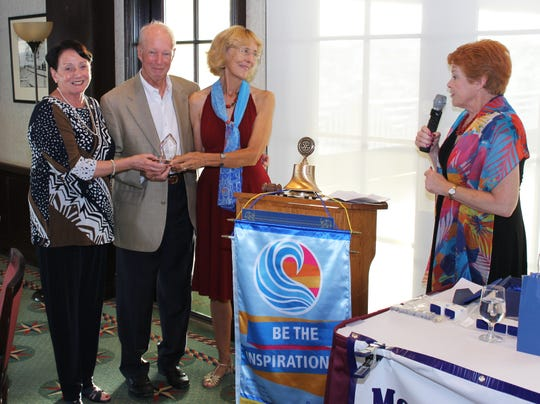 Rotary Foundation benefactors honored, from left, Pat Rutledge, outgoing president; Alan and Linda Sandlin, award recipients, Past District Governor Bobbi Bird.