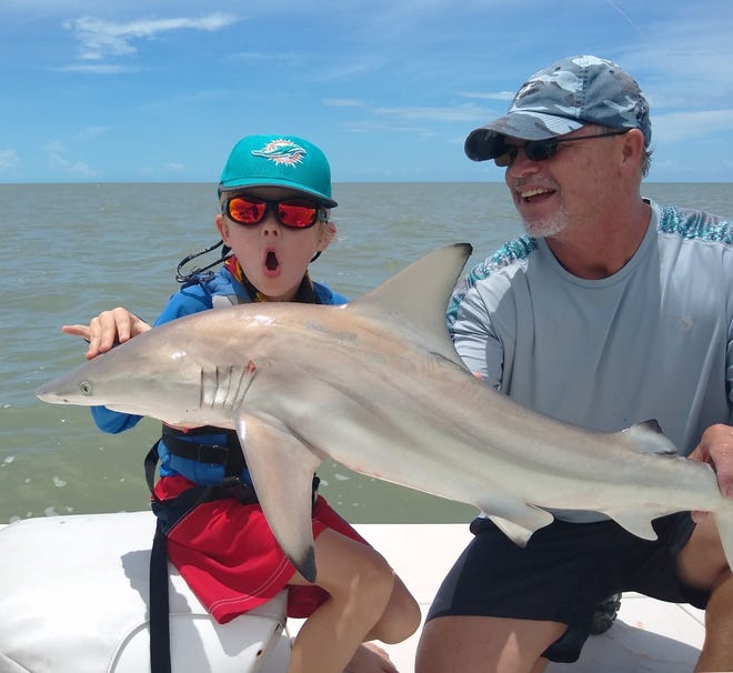 Logan Wells with. Blacktip Shark caught with Capt John Brossard off Marco Island, it was released alive to live another day.