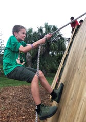 Scout Nathan Olsen on the obstacle course.
