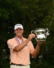 Madison's Steve Stricker poses with the trophy after winning the U.S. Senior Open by six strokes Sunday.