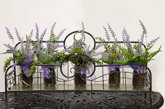 Flowerbed wall shelf.