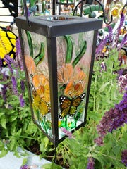Glass butterfly lantern.