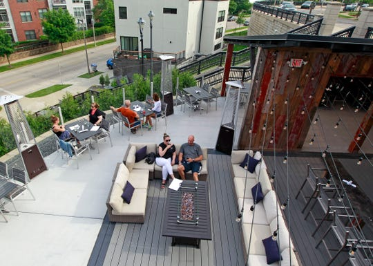 Customers dine and lounge at View MKE restaurant, 1818 N. Hubbard St., on the expanded lower patio called the Backyard. The large patio has its own bar and an area for private seating, plus fire pits, lounge seating and heaters.
