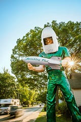 The newly-restored mid-century advertising icon Gemini Giant makes a towering comeback along Route 66 at the Launching Pad Drive-In in Wilmington, Ill.