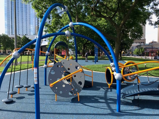 There are climbing structures, stepping stones, a bridge, tunnel and a small slide on this playground equipment at Cathedral Square Park.