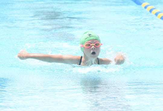 Callie Kohler swims a butterfly event for the Mountain Home Hurricanes at a recent home meet at Cooper Park.
