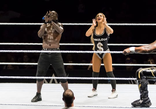 R-Truth (left) and Carmella (right) during a stop on the WWE SummerSlam Heatwave Tour
