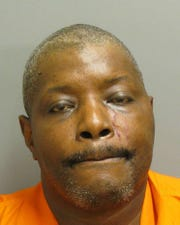 Moses Henry Cummings was charged with shooting into a hotel lobby where two people were standing.