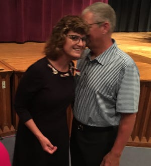 Lee Ann Kwiatkowski, hired on July 1, 2019, as the new Muncie Community Schools CEO and director of public education, talks with her husband.