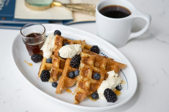 Waffles with whipped fromage blanc, berries and maple syrup at Liberty Common.