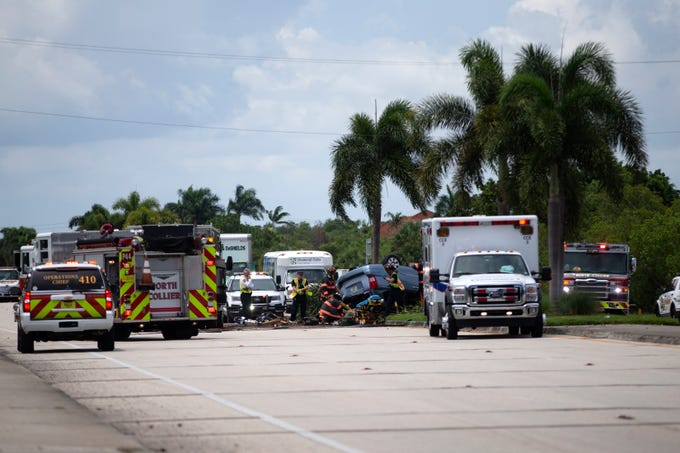 Emergency personnel work to free a person involved in a rollover accident, Monday, July 1, 2019, at the 12300 block of Tamiami Trail in North Naples.
