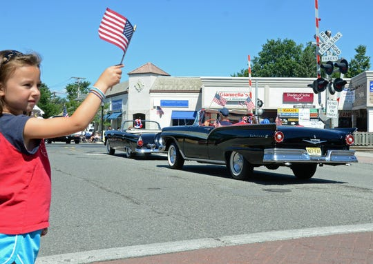 In this photo from the 2016 Fourth of July parade, Mary Kate, 6, from Glen Rock waves her flag.