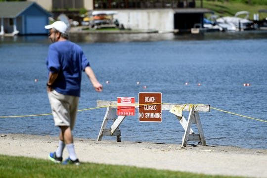 Despite the beach being closed at Hopatcong State Park, people can still enjoy the park along the Lake Hopatcong waterfront on Monday, July 1, 2019, in Landing, NJ. Due to the harmful algae bloom, swimming is not allowed in the lake until further notice.