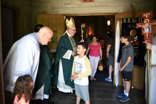 Seminarian Jim Hammill and Bishop George Lucey say good-bye to worshippers after mass at St. Francis of Assisi Church in Glen Ridge on June 30, 2019.