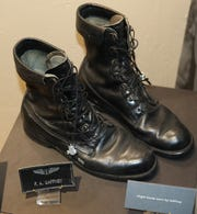 Boots worn by F. Drew Gaffney on display at the Carlsbad Museum and Art Center.