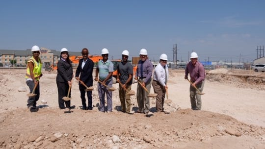 Hard hats abound at the ground breaking for the Best Western Plus in Carlsbad.
