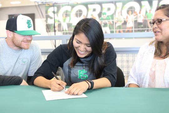Farmington's Niki Nakai signs her national letter of intent on Monday to continue her softball career at South Mountain Community College in Phoenix.