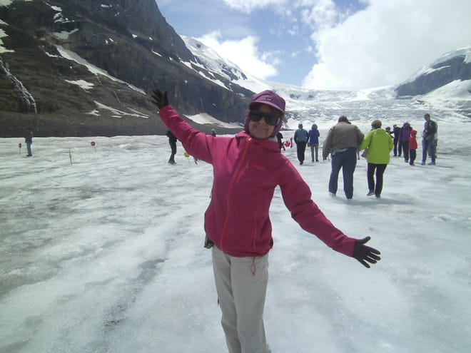 Yvonne revels in the experience of stepping on a real glacier in midsummer.