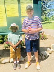 Dayton Reid (left) and Layne Broker place first and second among the 9-holers in Kensington's competition at Hartland Glen.