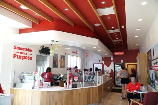 The interior of Livonia's Smoothie King features a red and white motif.
