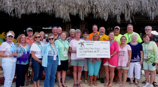 Parrot Heads of Pensacola donates $800 to Escambia Search and Rescue.