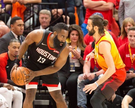 Jazz guard Ricky Rubio defends Rockets guard James Harden during the first quarter of Game 3 of a first round playoff series in 2019.