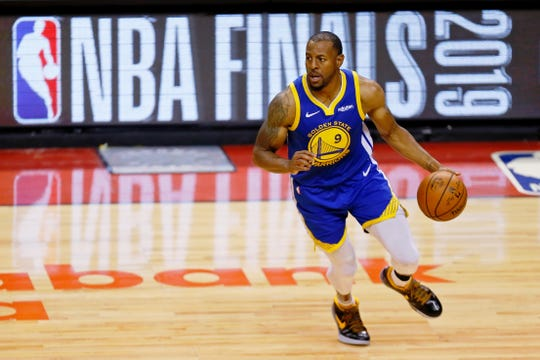 Jun 10, 2019; Toronto, Ontario, CAN; Golden State Warriors guard Andre Iguodala (9) dribbles against the Toronto Raptors during the fourth quarter in game five of the 2019 NBA Finals at Scotiabank Arena. The Golden State Warriors won 106-105. Mandatory Credit: John E. Sokolowski-USA TODAY Sports