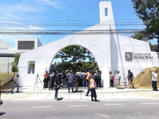 Media gathers outside the municipal cemetery in San Salvador, El Salvador, where the remains of Oscar Martínez and his daughter Valeria were returned June 30 after the two drowned crossing into the U.S.