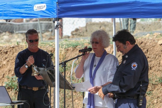 Marcie and Lew Theokas, who lost their grandson on June 30, 2013, read the names of the 19 fallen firefighters during a service to commemorate the deaths of the Granite Mountain Hotshots, at the future site of The Yarnell Hill Fire Memorial Park on June 30, 2019.