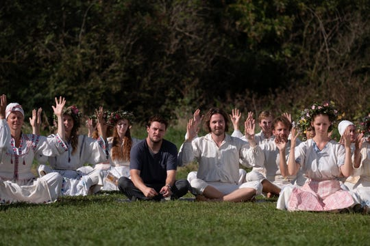 "Jack Reynor (center left) and Vilhelm Blomgren star in ""Midsommar."""