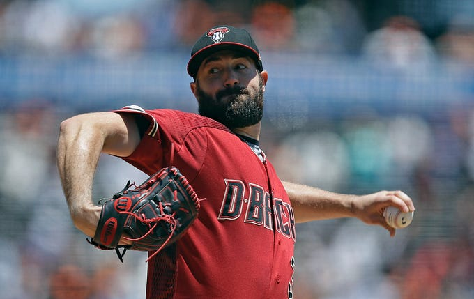 Arizona Diamondbacks pitcher Robbie Ray works against the San Francisco Giants in the first inning of a baseball game Sunday, June 30, 2019, in San Francisco.