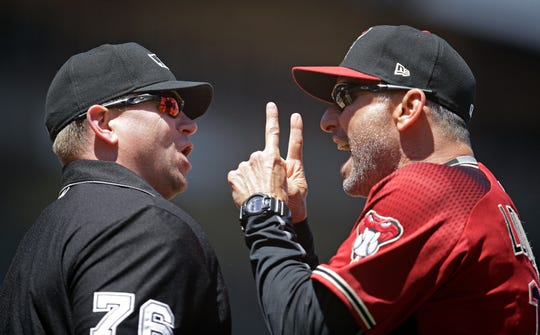 Arizona Diamondbacks manager Torey Lovullo, right, gestures to home plate umpire Mike Muchlinski after his ejection in the fifth inning of a baseball game against the San Francisco Giants, Sunday, June 30, 2019, in San Francisco.