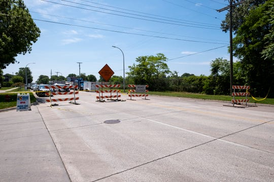 10th Street in Port Huron remains closed Monday as crews continue to work the scene of Friday's derailed train.
