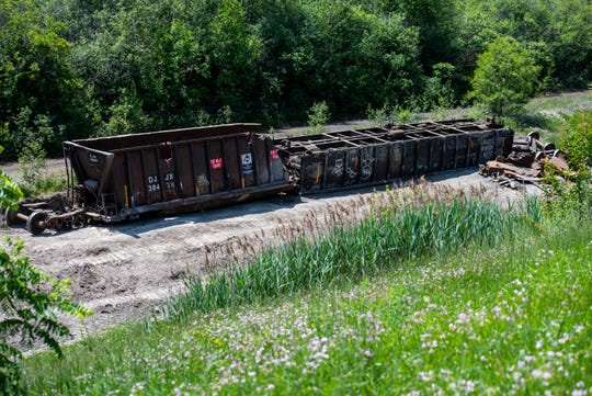 Destroyed train cars are scene off the tracks near the international tunnel to Sarnia, where a train derailed Friday morning.