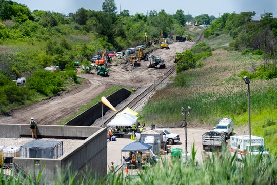 Crews work Monday afternoon, July 1, 2019, to repair the tracks through the international train tunnel to Sarnia, where a train derailed Friday morning.