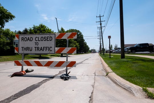 16th Street in Port Huron remains closed Monday as crews continue to work the scene of Friday's derailed train.