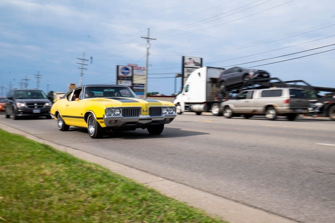Cars cruise along 24th Avenue on Blue Water Cruise Night Friday, June 28, 2019 in Fort Gratiot.