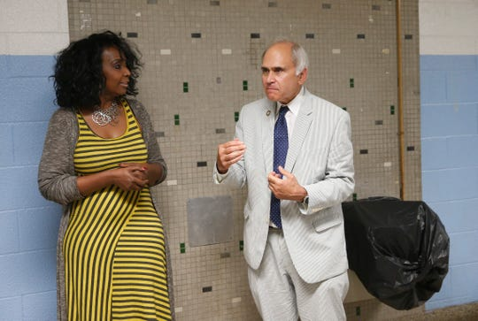 Poughkeepsie City School District board President Felicia Watson and New York State Assemblyman Jonathan Jacobson speak beside an out of service water fountain at Poughkeepsie Middle School on July 1, 2019.